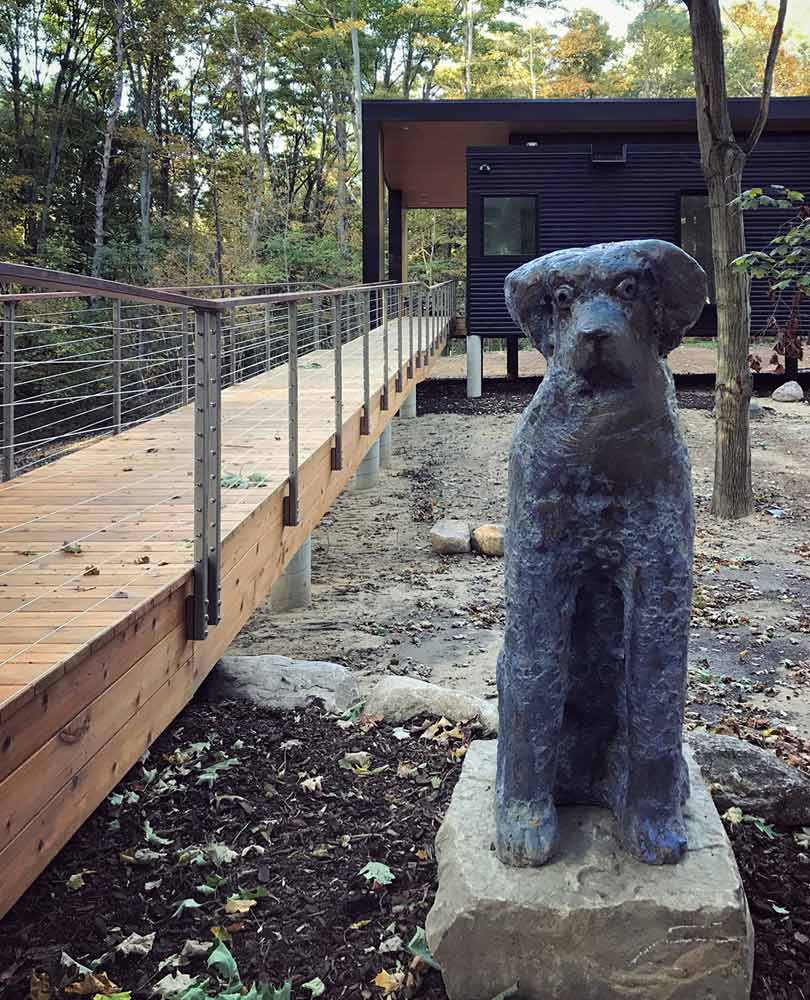 Curious Friend Stands Watch - Bronze Dog Sculpture - Bridge House - Douglas, Michigan