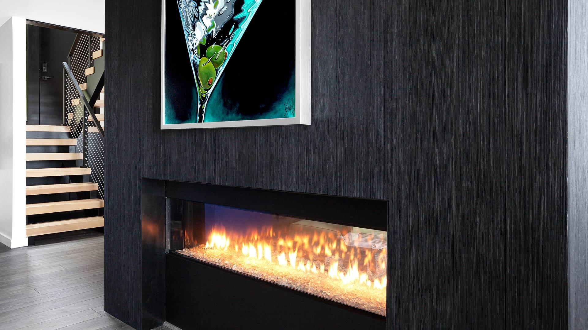 Charred wood and steel wrap gas two-sided fireplace - custom Eastern White Pine stair treads with open riser and cable rail system make up entry stair - Lakeside Modern Cottage (H-LODGE) - Unionville, Indiana, Lake Lemon