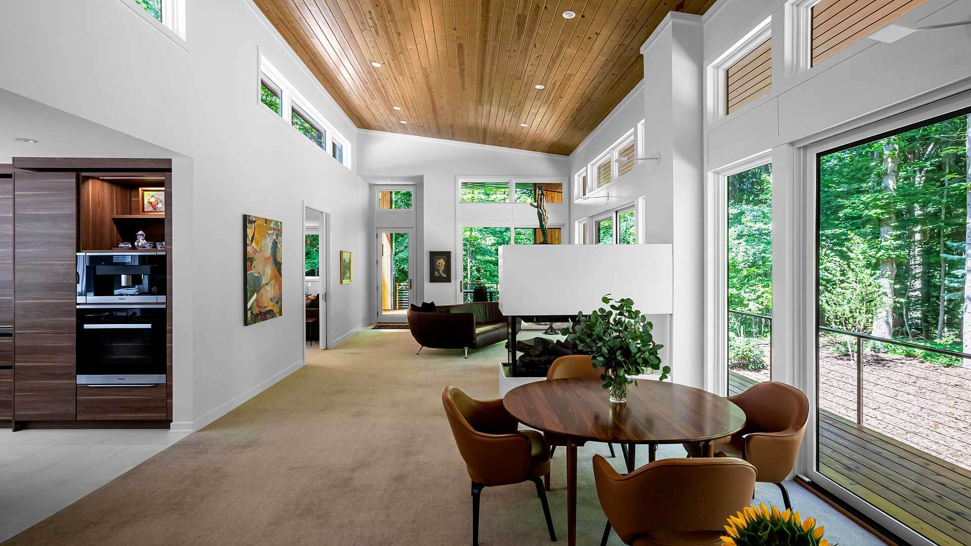Open concept Living-Dining space optimizes natural light and panoramic views of Pier Cove Valley - Bridge House - Fenneville, Michigan - Lake Michigan