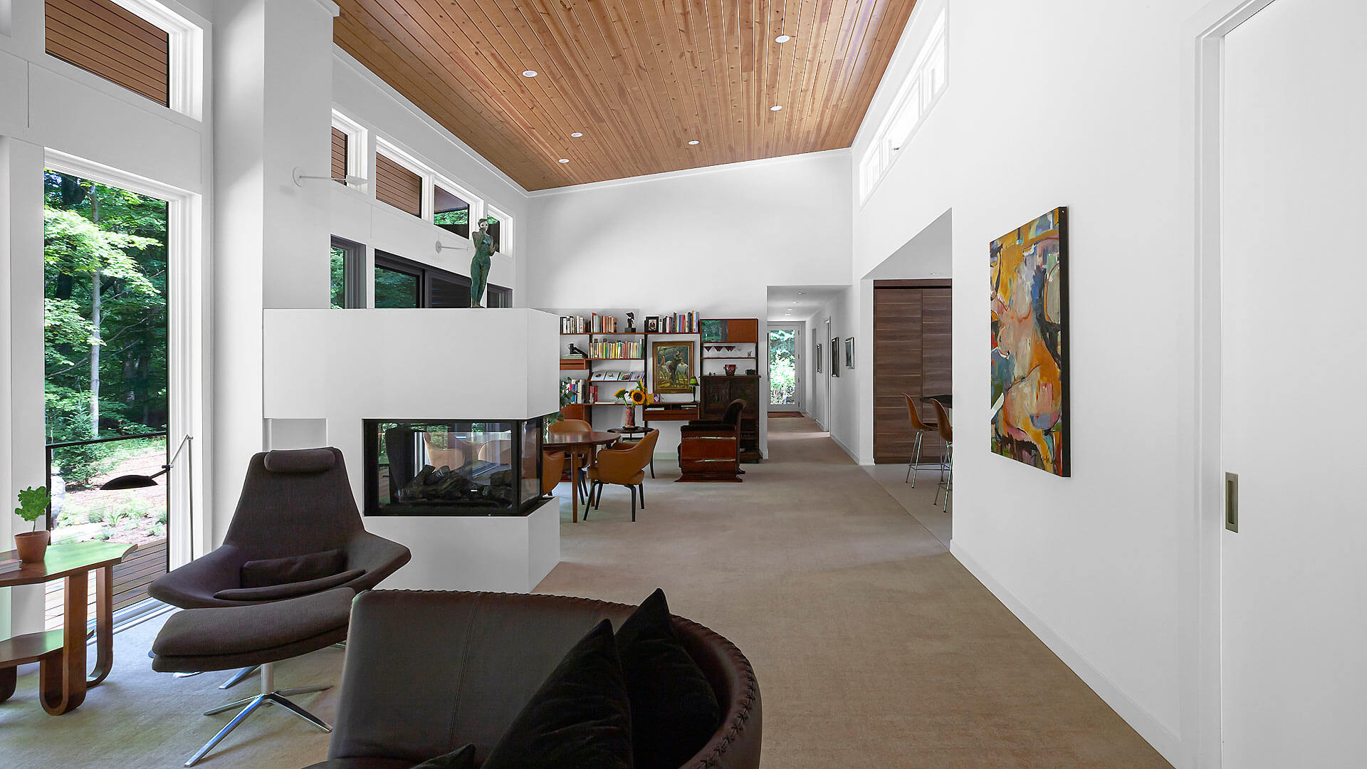 Open concept Living-Dining space optimizes natural light and panoramic views of Pier Cove Valley (photo view looking east) - Bridge House - Fenneville, Michigan - Lake Michigan