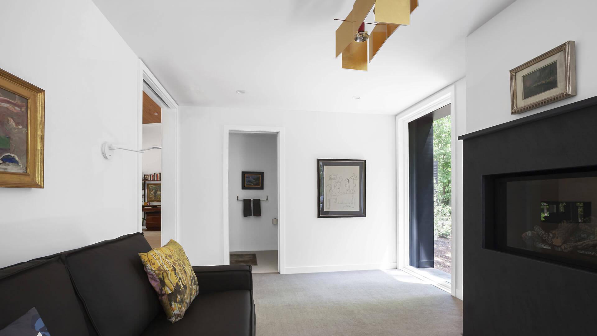 Guest Studio includes sleeper sofa, gas fireplace, and lighting by 24 Karat Blau® Pendant Lamp by Ingo Maurer - Bridge House - Fenneville, Michigan - Lake Michigan