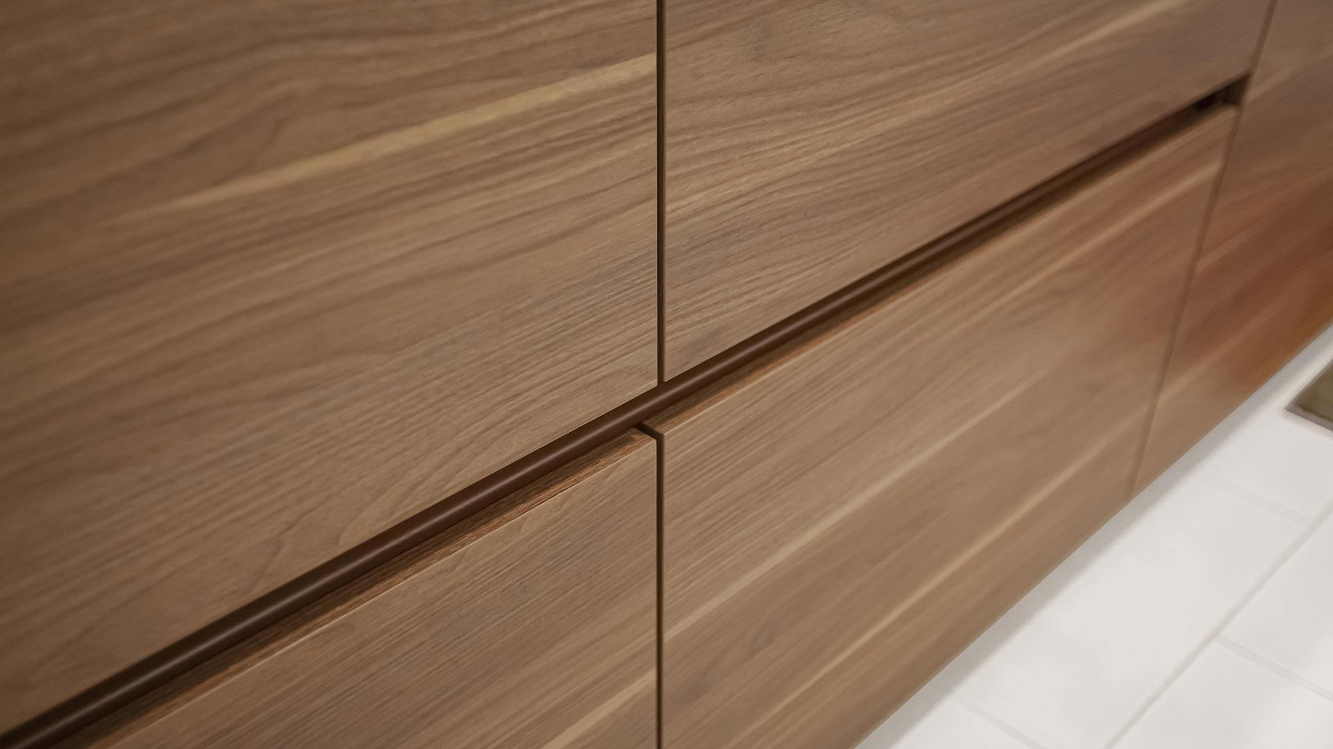 Kitchen cabinet bases comprise wood veneer clad drawers with integrated drawer pull detail - Bridge House - Fennville, Michigan - Lake Michigan