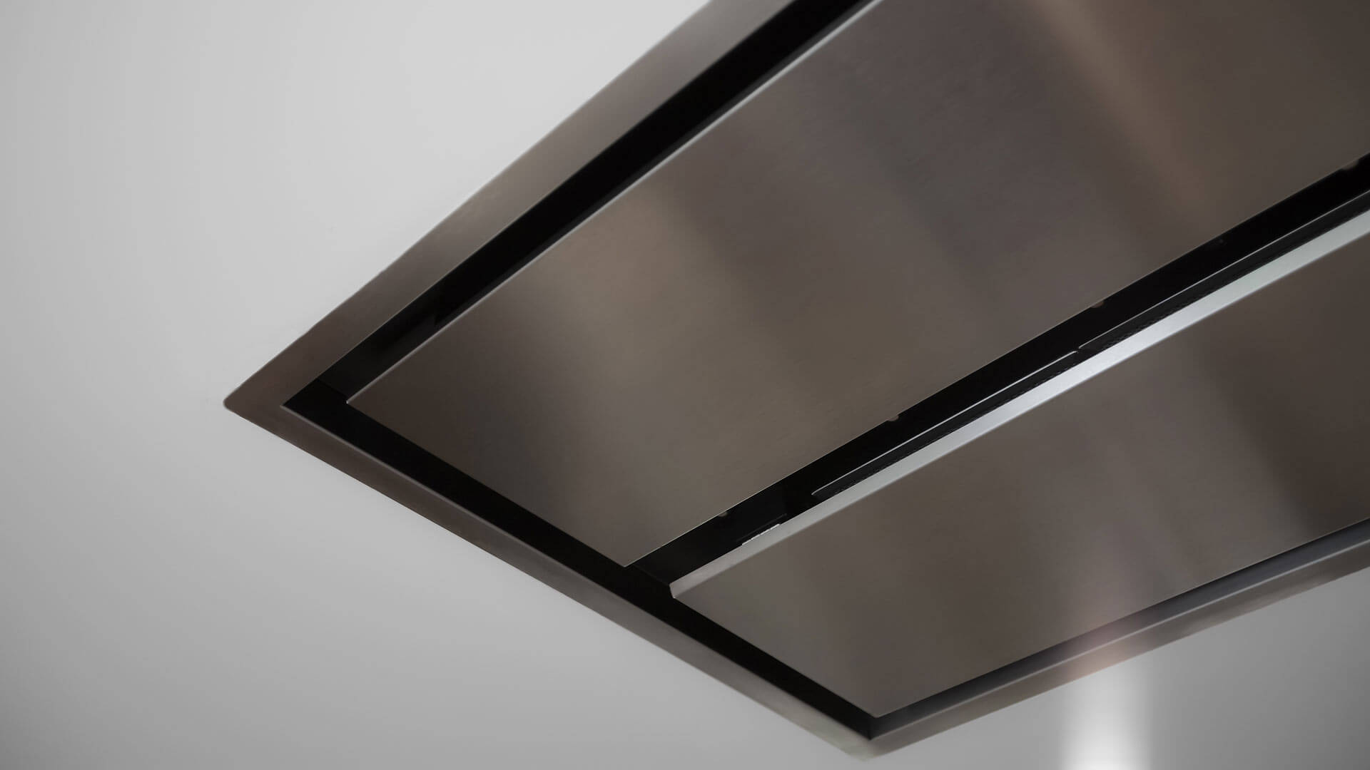 Kitchen range hood is direct-mounted to ceiling for a minimal look - Bridge House - Fenneville, Michigan - Lake Michigan
