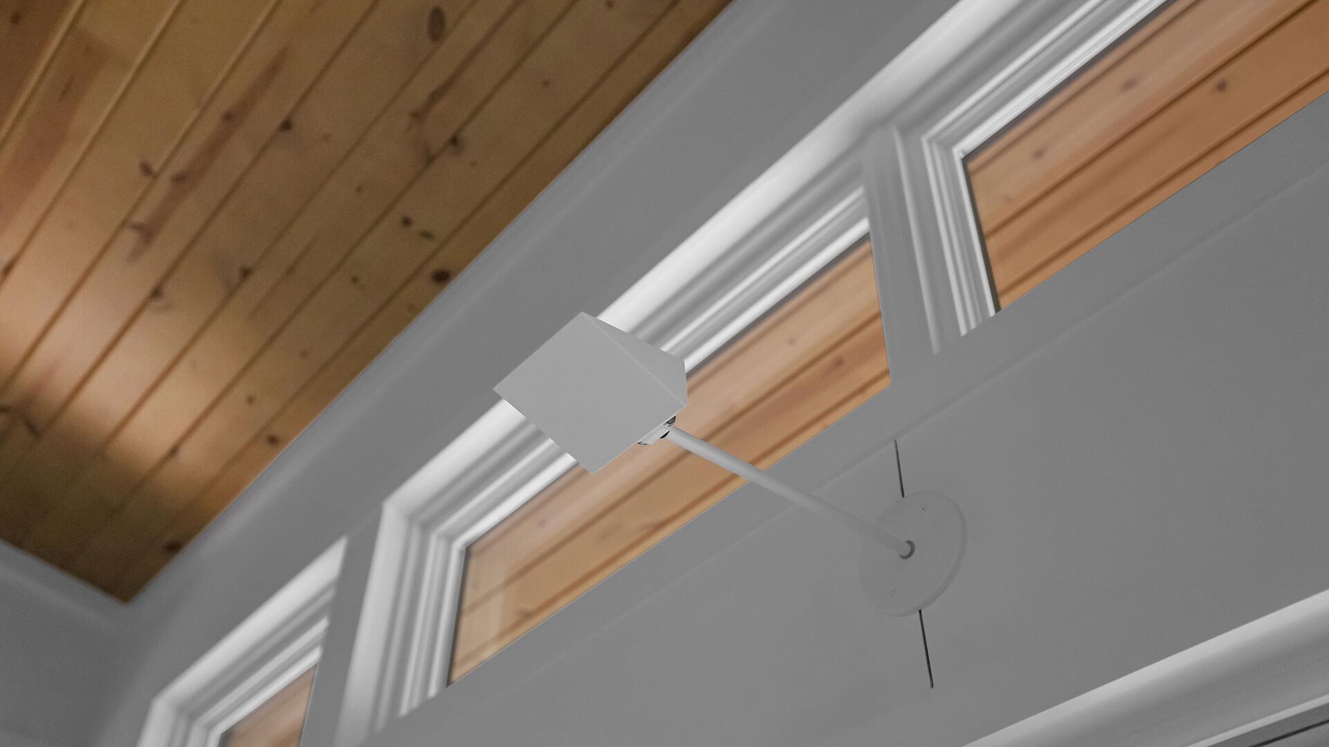 Uplights highlight wood ceilings in vaulted living room - Bridge House - Fennville, Michigan - Lake Michigan