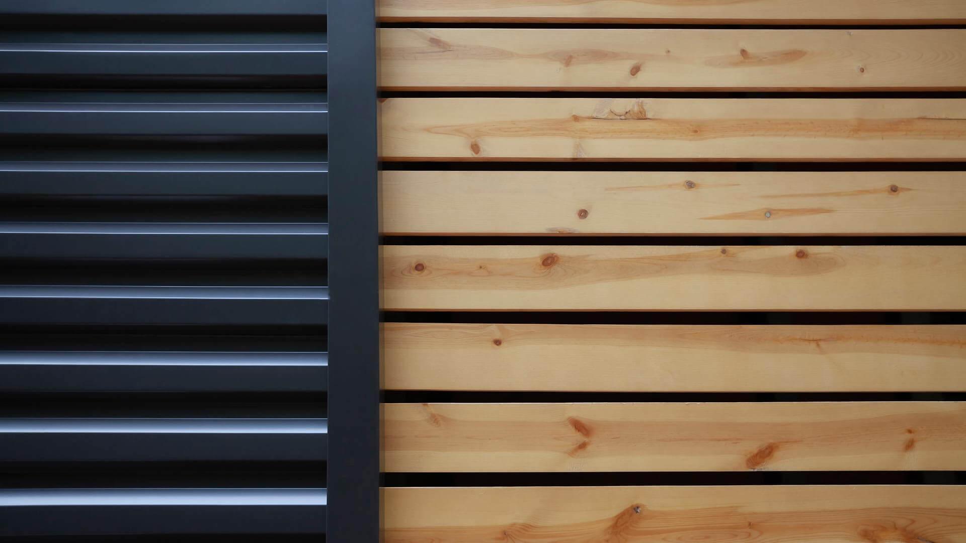 Exterior siding detail highlights dark bronze horizontal profile + pine screenwall enclosing dog run - Bridge House - Fenneville, Michigan - Lake Michigan