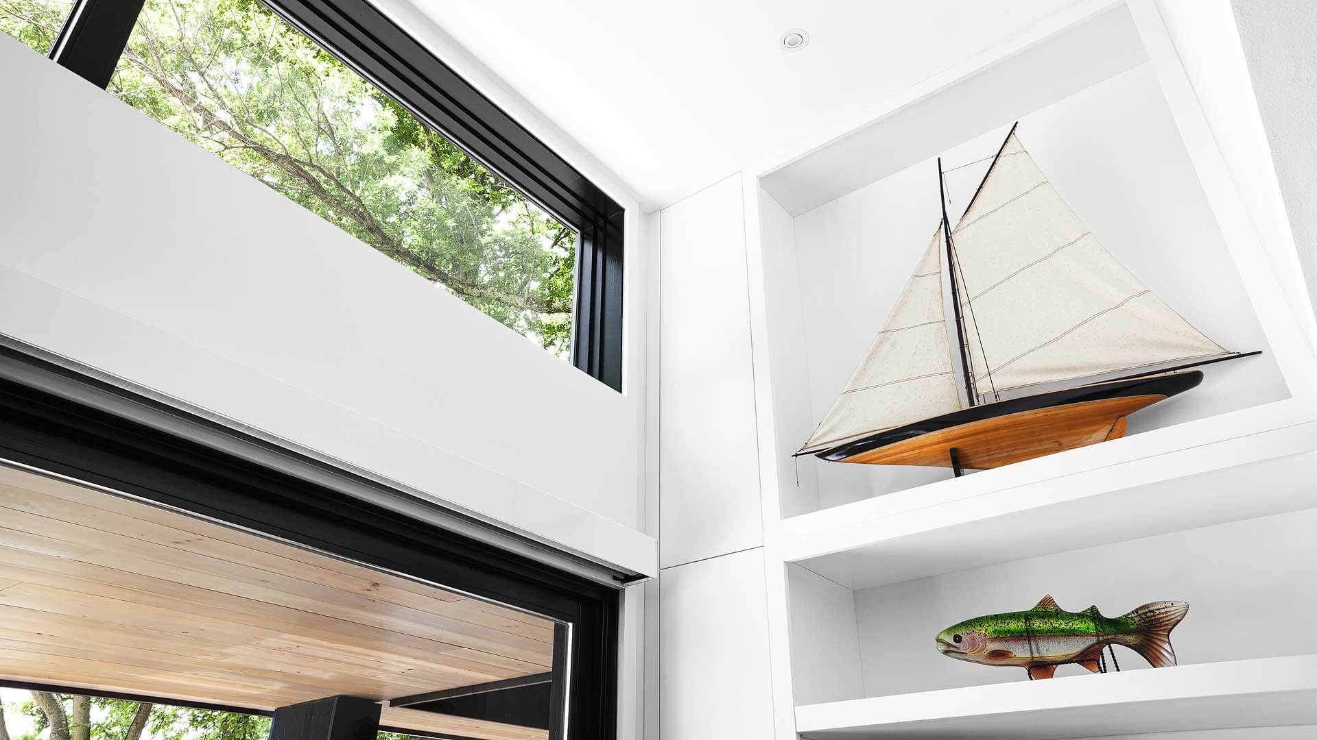 custom cabinet fills clerestory and provides display shelves for sailboat and fish - Lakeside Modern Cottage (H-LODGE) - Unionville, Indiana, Lake Lemon