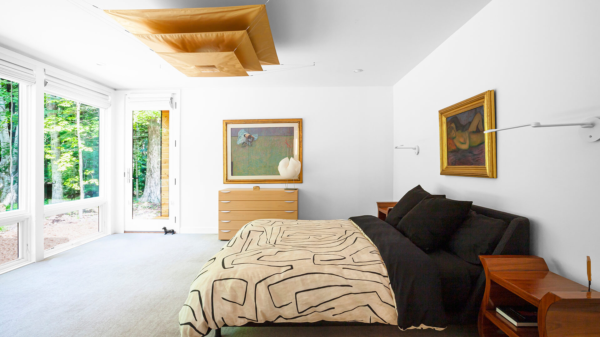 View into Master Bedroom features curated artwork, furniture, and light fixtures - Ingo Maurer - Bridge House - Fenneville, Michigan - Lake Michigan