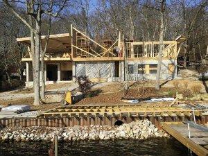 View of framing progress from dock - Modern Lakeside Retreat - Grandview Lake - Columbus, Indiana