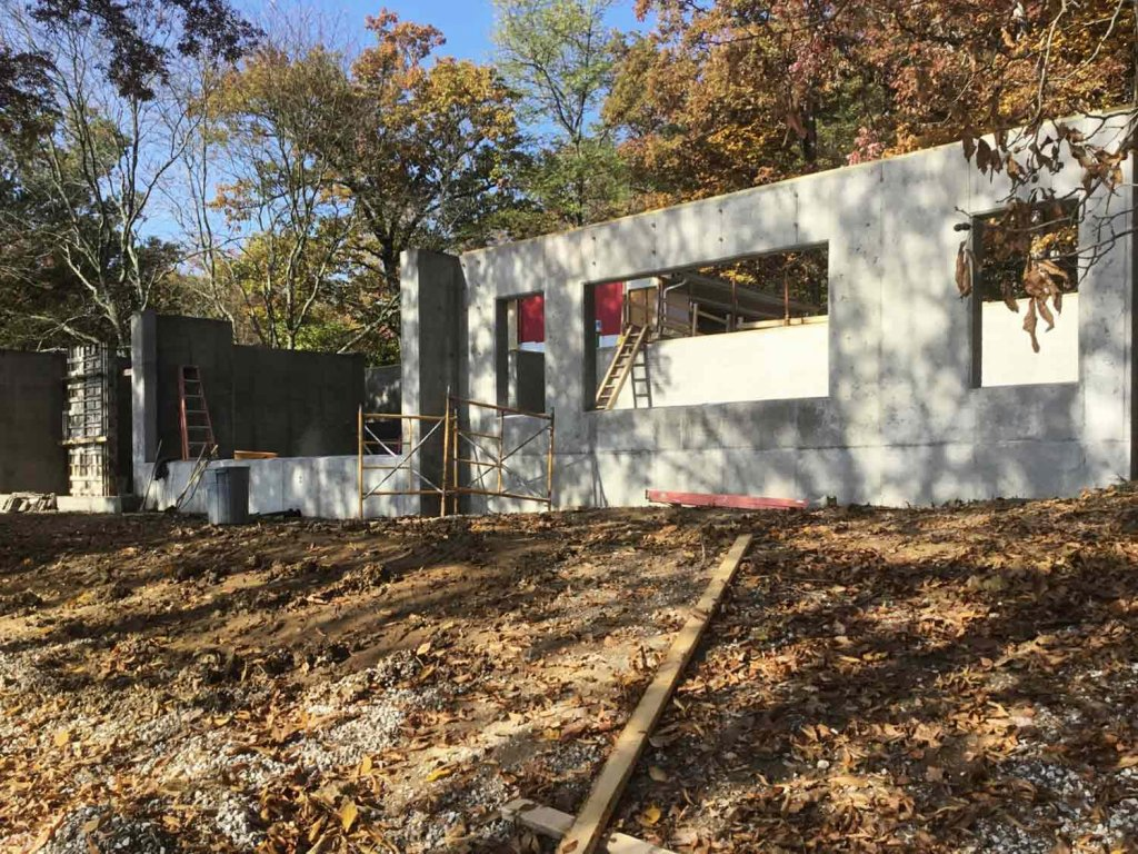 Lakeside exposed basement walls complete (forms pulled) - Modern Lakeside Retreat - Grandview Lake - Columbus, Indiana