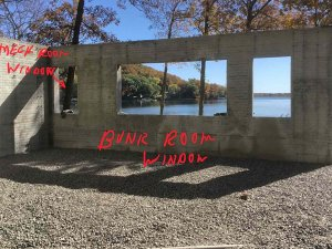 Lakeside exposed basement walls complete (forms pulled) - this view is from interior through Bunk Room openings to lakeside view - Modern Lakeside Retreat - Grandview Lake - Columbus, Indiana