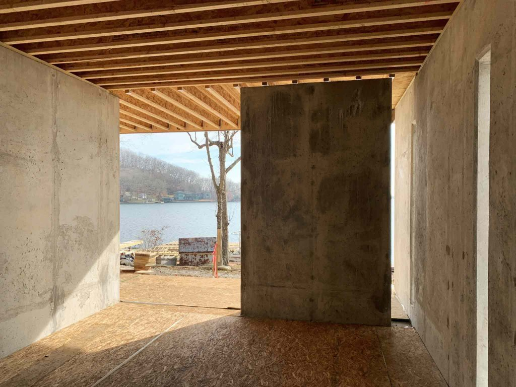 Side Storage Porch Foundation Walls Competed (smooth concrete) - Modern Lakeside Retreat - Grandview Lake - Columbus, Indiana