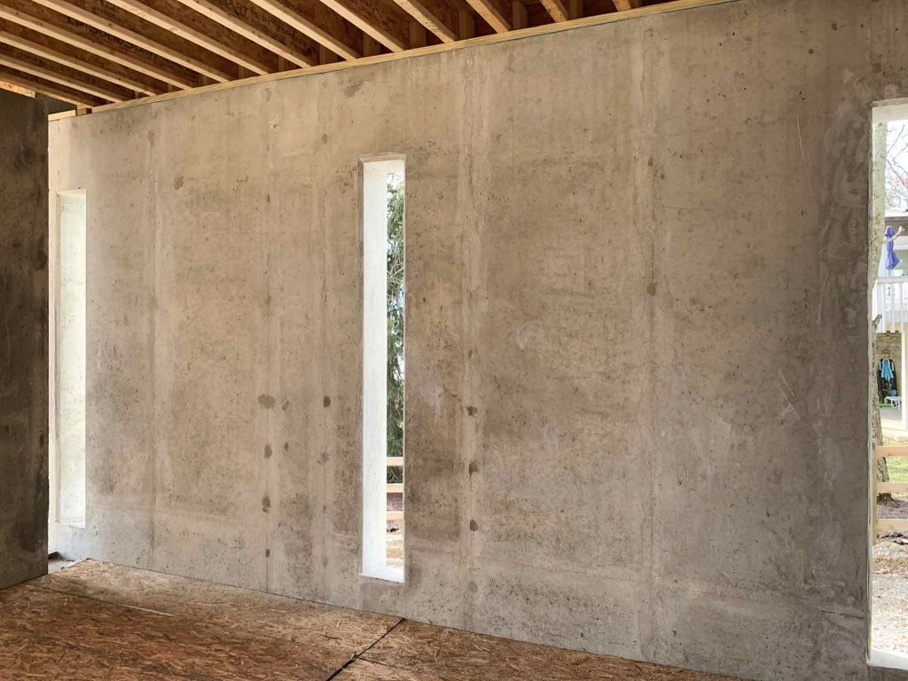 Storage Room integrates smooth concrete walls with vertical slots - Modern Lakeside Retreat - Grandview Lake - Columbus, Indiana