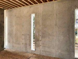 Storage Room integrates smooth concrete walls with vertical slots - Modern Lakeside Retreat - Grandview Lake - Columbus, Indiana